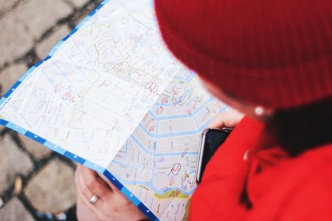 person looking at map for guidance