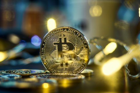 Bitcoin with a background of gold